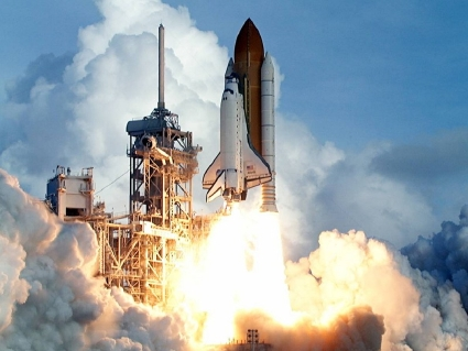 Space shuttle taking off from launch pad